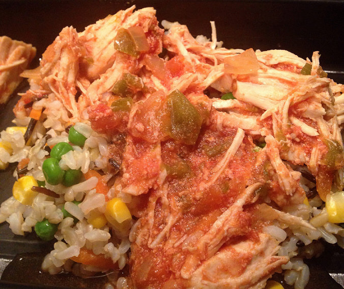 healthy crockpot salsa chicken over rice and veggies