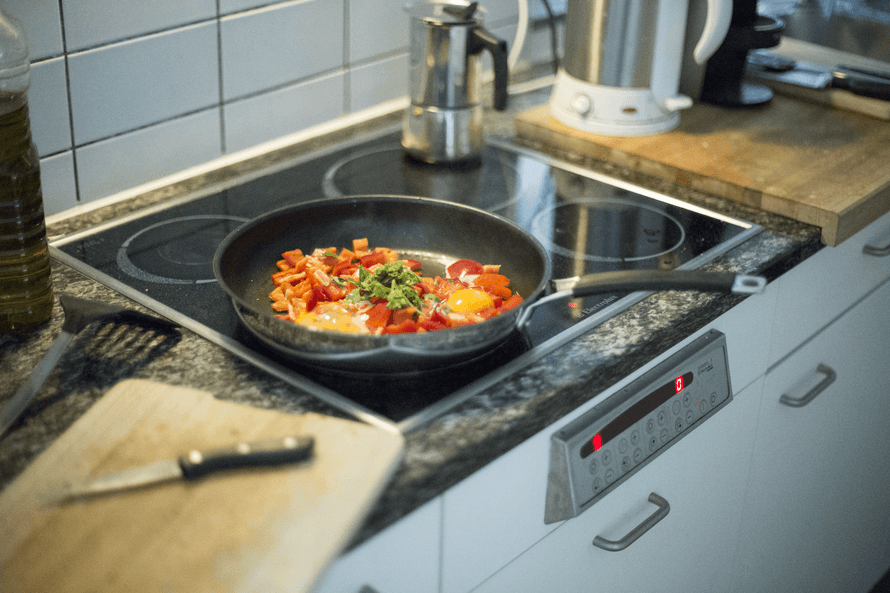 cooking dinner in a pan on the stove