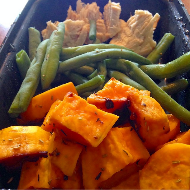 sweet potatoes, green beans, and chicken in a tupperware for meal prep