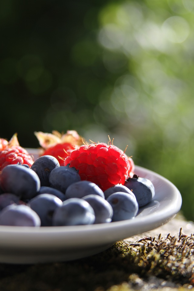 a bowl of blueberries and raspberries