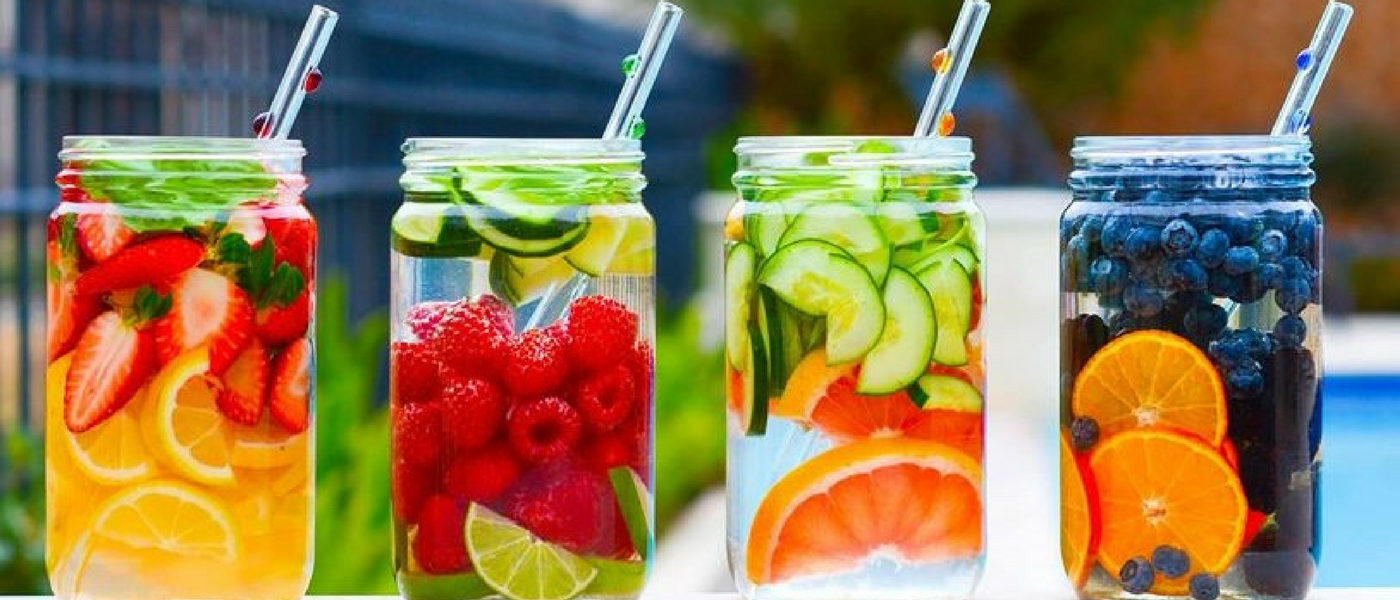 4 jars with fruit infused water